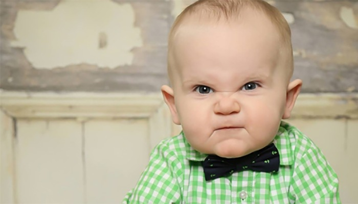 angry baby in green